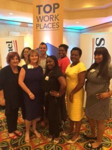 Alternative Home Health Care team members at the Sun Sentinel's Top Workplaces award presentation.